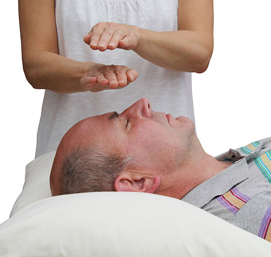 What Are The Benefits Of Online Reiki Attunement Compared To A Group Reiki Course?